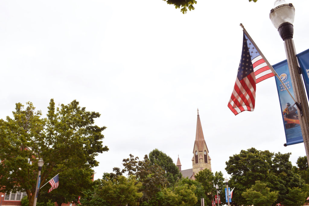 American Flag and Downtown Two Rivers